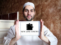 New Line Cinema company logo. Logo of the american New Line Cinema company on samsung tablet holded by arab muslim man Stock Images