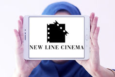 New Line Cinema company logo. Logo of the american New Line Cinema company on samsung tablet holded by arab muslim woman Royalty Free Stock Photography