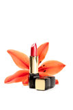 New lipstick and lily flowers, on white Stock Photos