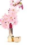 New lipstick with sakura flowers, on white Stock Images