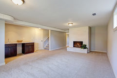 New living room with  carpet and fire place. Royalty Free Stock Photo