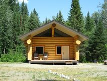 New log cabin. Remote into this wilderness stands a newly build log cabin royalty free stock photos