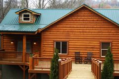 New Log Home With Large Deck. New large home with a large deck Royalty Free Stock Image