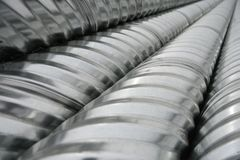 New long corrugated shiny aluminum metal pipes royalty free stock images