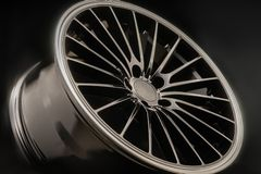 New Luxury Black alloy Wheel, sporty with thin spokes, close up on black background. New Luxury Black alloy Wheel, sporty with thin spokes, close up on black royalty free stock photo