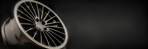New Luxury Black alloy Wheel, sporty with thin spokes, copy cpace on black background. New Luxury Black alloy Wheel, sporty with thin spokes, copy cpace on stock photography