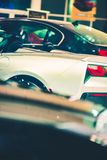 New Luxury Cars For Sale. Included Convertible Super Car. Vertical Photo. Dealer Showroom Royalty Free Stock Image