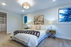 New luxury custom built home with white master bedroom. New luxury custom built home features white master bedroom with walk in closet stock images
