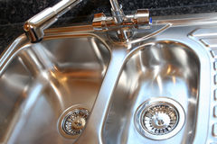 New Luxury Steel Kitchen Sink. Kitchen sink. Selective focus on mixer/rear drainer Stock Image