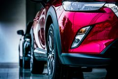 New luxury SUV compact car parked in modern showroom for sale. Car dealership office. Car retail. Shop stock images