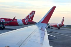 KLIA2 - Air Asia flight. The new Malaysia Airport KLIA2 is measured to be at least 257,000 sqm, with 60 gates, 8 remote stands, 80 aerobridges, plus a retail royalty free stock photography