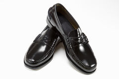 New man's pair of black shoes. Pair of new man's black shoes on white Stock Photo