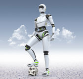 New mankind. Robot standing in the desert with his foot on the skull Royalty Free Stock Image