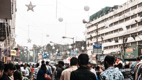 New Market Kolkata 25 December 2018 - Crowd of anonymous people walking on busy city street in christmass season. New Market or stock photo