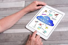 New marketing concept on a tablet. New marketing concept shown on a tablet used by a woman royalty free stock photos