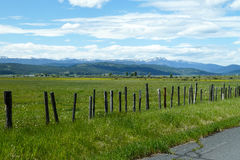 New Meadows, Idaho. Beautiful valley view, ancient fence. cow herds, rugged mountains in the background stock photos