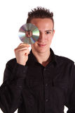New media. A handsome teenager with a CD or DVD. All isolated on white background Stock Photos
