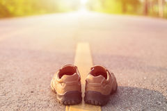 New men fashion shoes on asphalt road beside yellow stripe Royalty Free Stock Photo