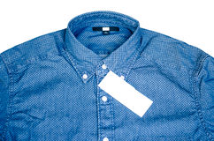 New men's shirt blue and label Stock Photography