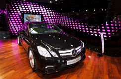 New Mercedes E class in the showroom. New Mercedes E class in black color in the showroom on Champs-Élysées in Paris. Car located among colorful lights and Stock Photography