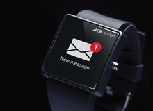 New message icon with smartwatch. Royalty Free Stock Images