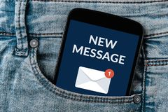 New message notification concept on smartphone screen in jeans p. Ocket. All screen content is designed by me Stock Photography