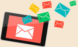 New message. On the tablet was sent a new message. Envelope symbol Royalty Free Stock Image