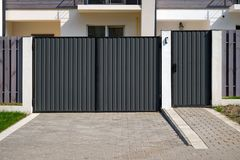 New metal gates and a fence in front of the house Stock Images