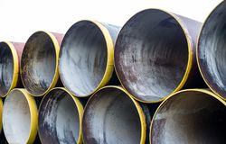 New metal pipes stack. Stack of new metal pipes with yellow-painted edges Stock Images