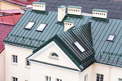 New metal roof with skylights and chimneys Stock Photo