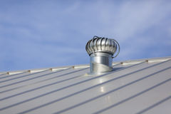 New Metal Roof. Stock photo of an attic vent on a freshly installed, brand new metal roof at a residential home stock photo