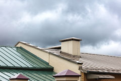 New metal roofs of old houses wet after heavy rain Royalty Free Stock Image