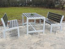 New metal and wooden park benches with table Stock Photo