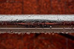 A new metallic shining tube with drops of water after a rain Stock Image