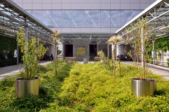 New metro station Mlociny. WARSAW, POLAND - June 7, 2015. A new metro station Mlociny. Space near the entrance is decorated with bushes and trees. Warsaw Stock Photo