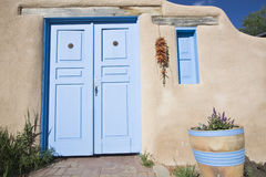 New Mexican styled front door and window. Taos, NM stock images