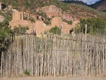 New Mexico adobe hillside fence primitive old. Clay fort picturesque Landmark stock photography