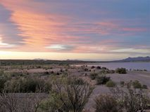 New Mexico Caballo Lake Sunset. The Caballo Mountains silhouette against the southwest sky behind Caballo Lake in southern New Mexico royalty free stock photography