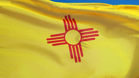 New Mexico flag in slow motion seamlessly looped with alpha. New Mexico flag waving in slow motion against clean blue sky, seamlessly looped, close up, isolated stock video