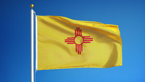New Mexico flag in slow motion seamlessly looped with alpha. New Mexico flag waving in slow motion against clean blue sky, seamlessly looped, close up, isolated stock footage