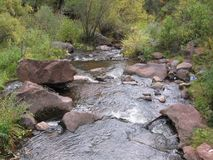 New Mexico hillside waterfalls stream whitewater river rocks wet water. Rapids royalty free stock photos