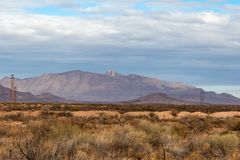 New Mexico Landscape. A remote New Mexico landscape, with mountains beneath a cloudy sky stock photo