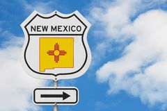 New Mexico map and state flag on a USA highway road sign. With sky background stock photo