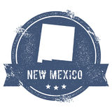 New Mexico mark. Travel rubber stamp with the name and map of New Mexico, vector illustration. Can be used as insignia, logotype, label, sticker or badge of Stock Image