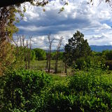 New Mexico Spring. A view from the deck of a casita in Taos, New Mexico reveals a stunning view of an upcoming storm Royalty Free Stock Photography