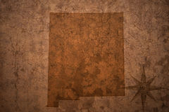 New mexico state map on a old vintage paper background. New mexico state map on a old vintage crack paper background Stock Photography