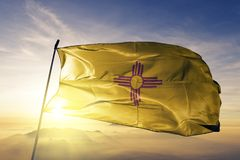 New Mexico state of the United States of America flag textile cloth fabric waving on the top. New Mexico flag textile cloth fabric waving on the top sunrise mist royalty free illustration