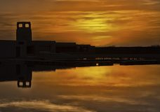 New Mexico Sunset. A beautiful sunset and historic tower reflected in the waters of a New Mexico lake stock photo