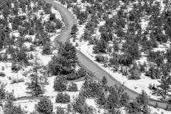 A New Mexico Winter Landscape. Looking down on a road winding through a New Mexico landscape, with snow on the ground royalty free stock photography