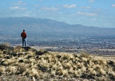 View of Albuquerque and the Sandia mountains from the volcanic mesa royalty free stock image